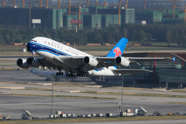 China Southern Airlines will send 250 aircraft and 20,000 employees to the new Beijing Daxing International Airport, which is being built south of the city center. Above, a China Southern-owned Airbus A380 takes off from Beijing Capital International Airport in November 2011. Photo: Visual China
