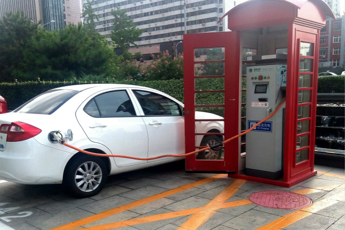 Auditing firm KPMG said that artificial intelligence and auto technology stood out as key sectors that attracted investment on the Chinese mainland in the third quarter. Above, an electric car is charged in Beijing on Aug. 17. Photo: Visual China