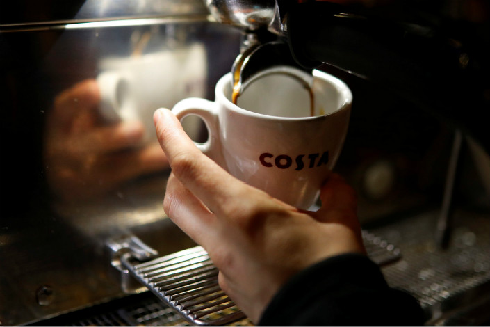 Whitbread PLC, owner of the Costa coffee chain, said its buyout of its South China partner won't affect its North China operations, which are conducted through a separate 50-50 joint venture with BHG. Above, a Costa barista makes a cup of coffee at a shop near Manchester, England, on May 5. Photo: Visual China