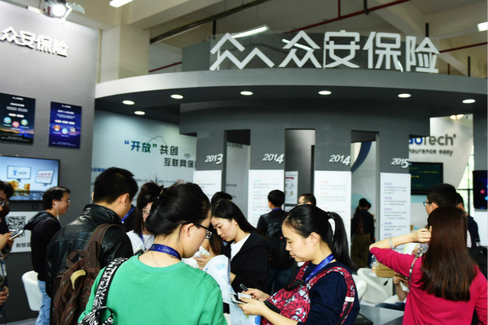 ZhongAn Online Property & Casualty Insurance's announcement of a joint venture to create a microfinance firm comes weeks after ZhongAn's Hong Kong IPO, which raised $1.5 billion. Above, A ZhongAn Insurance booth is seen in Hangzhou in October 2015. Photo: Visual China