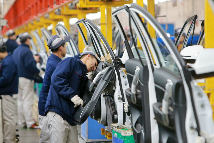 Great Wall Motor did not specify whether a potential tie-up with BMW would make gasoline-powered Mini models or electric ones, though there has been speculation that a joint venture would manufacture electric-powered versions of the popular car. Above, workers assemble doors at a Great Wall auto factory in China's northern city of Tianjin. Photo: Visual China