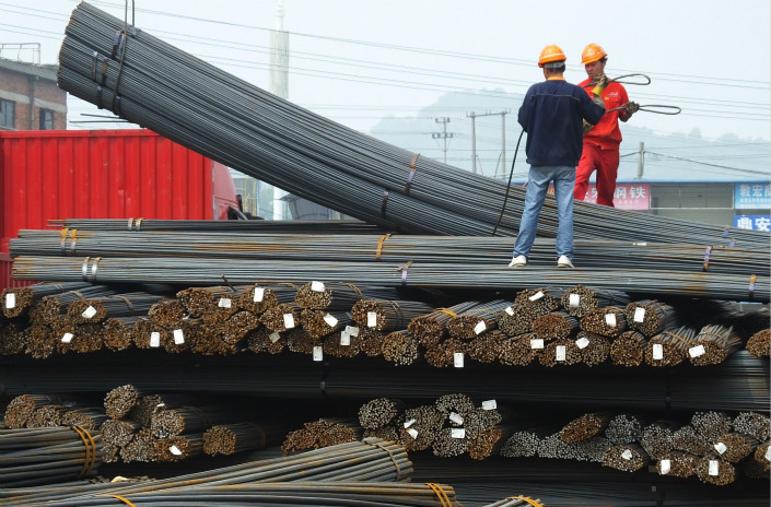 China's slowing economic expansion and its shift away from a growth model that depends on manufacturing and investment have dampened demand for steel over the past few years. Above, workers unload steel in Yichang, Hubei province, in April 2016. Photo: Visual China