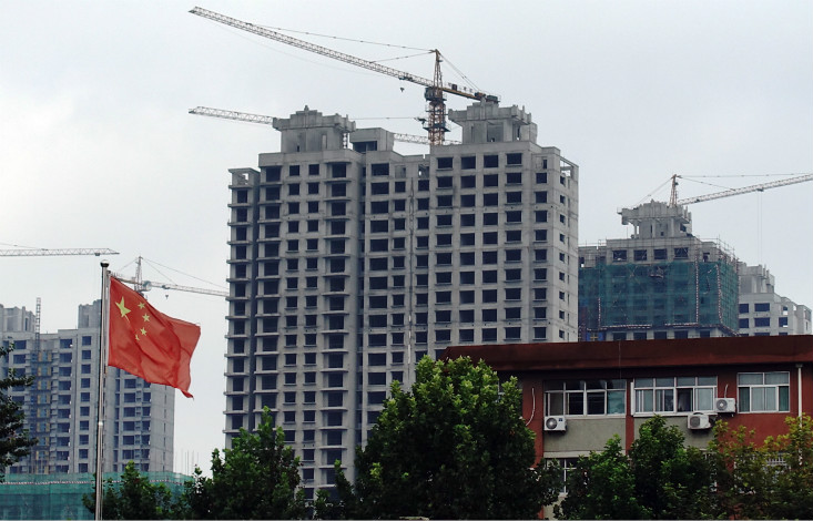 The July-through-September quarter marked the first time that quarterly GDP growth slowed since the January-through-March period in 2016. Above, building construction takes place in Dezhou, Shandong province, on Aug. 30. Photo: Visual China