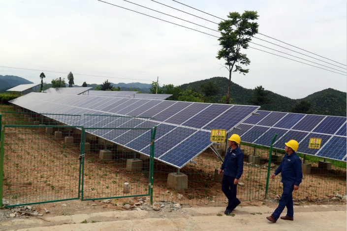 While all solar power-generating facilities are allowed to sell their electricity to the national grid at above-market rates, these rates were lowered last year for larger farms but kept unchanged for distributed systems. Photo: Visual China
