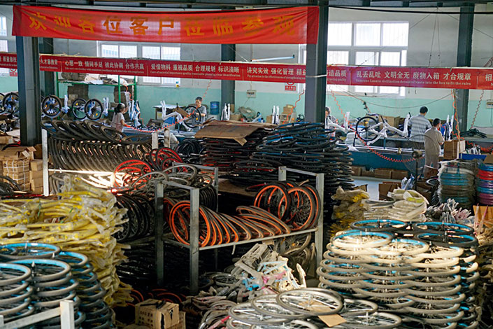 Bicycle parts are stacked ready for assembly at the Lexus bike factory in the village of Wangqingtuo, Tianjin, as workers put bikes together on the production line. Making a bike requires about 10 separate procedures, which can all be completed in less than 10 minutes.