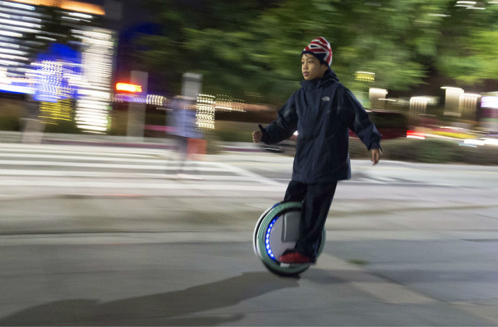 The artificial-intelligence efforts of Ninebot Ltd., the Chinese manufacturer of the Segway, has won support from the Chinese government, which selected the firm to help draft standards for self-balancing transportation systems. Above, 9-year-old Rayen Koan rides his Segway in Los Angeles in December 2015. Photo: Visual China