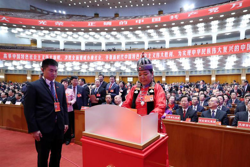 A  delegate casts her ballot in elections for the Communist Party's Central Committee and the party's top anti-graft agency, the Central Commission for Discipline Inspection, at the 19th National Party Congress, held in the Great Hall of the People in Beijing. Photo: Xinhua