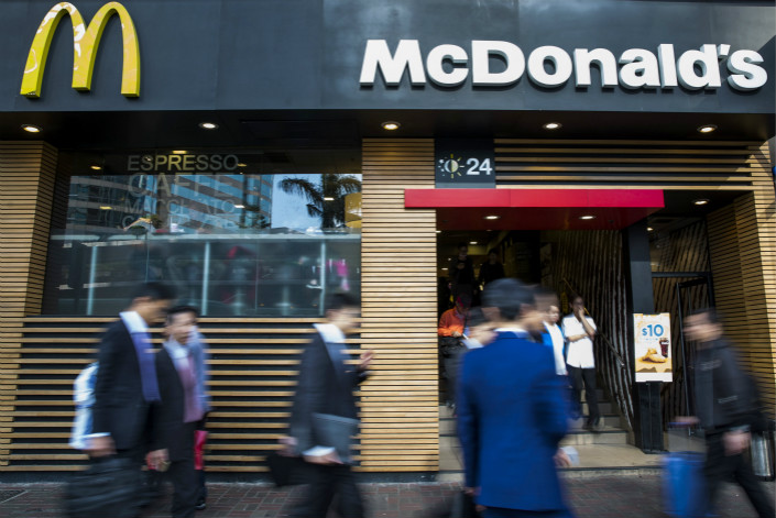 Although the owners of McDonald's China have changed the name of the franchise to Golden Arches China, or Jingongmen, the restaurants themselves will continue to be identified by Chinese characters that spell out the original Mandarin name — Maidanglao. Photo: Visual China