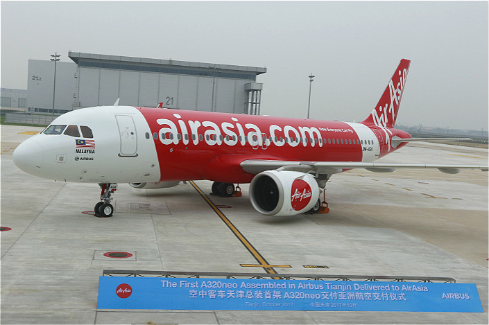 The first A320neo aircraft assembled at the Airbus Final Assembly Line Asia in Tianjin is displayed in the city on Wednesday during the ceremony to mark its delivery to Malaysian airliner AirAsia Berhad. Photo: IC