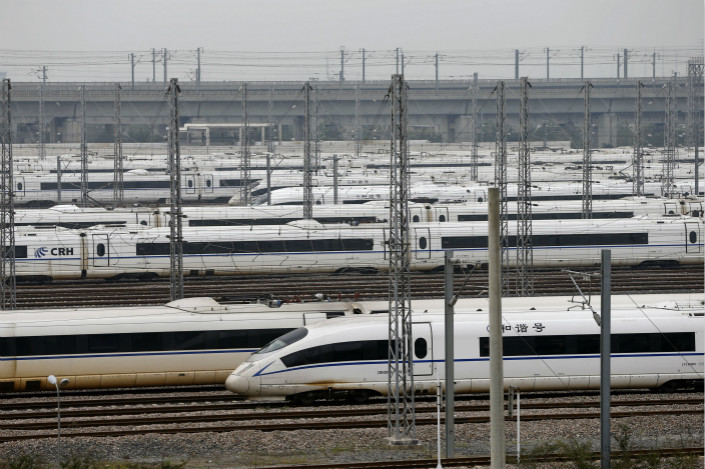 The new carriages for China's high-speed trains will eliminate current limitations on the length of the trains, allowing them to be as short as two carriages to as many as 16. Above, high-speed trains are parked in Shanghai in Oct. 2015. Photo: Visual China