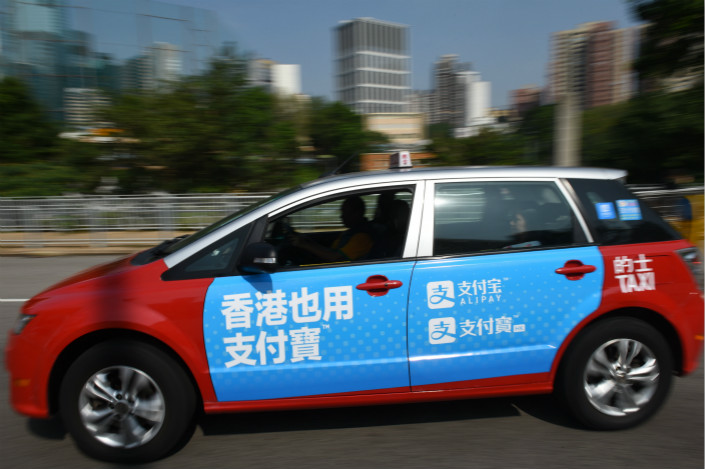 Mobile payment platform Alipay and taxi-hailing service Didi Chuxing are following a global expansion path similar to many Chinese service operators by making their services available first to millions of Chinese traveling overseas. Photo: Visual China