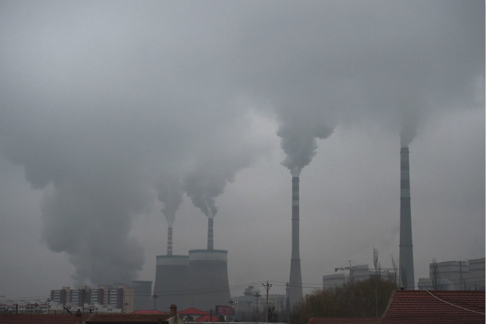 "Shanxi province has told its local governments to hold businesses and individuals that fail to comply with emergency anti-pollution measures ""strictly accountable."" Above, smoke belches from a coal-fired power station near Datong, Shanxi province, in November 2015. Photo: Visual China"