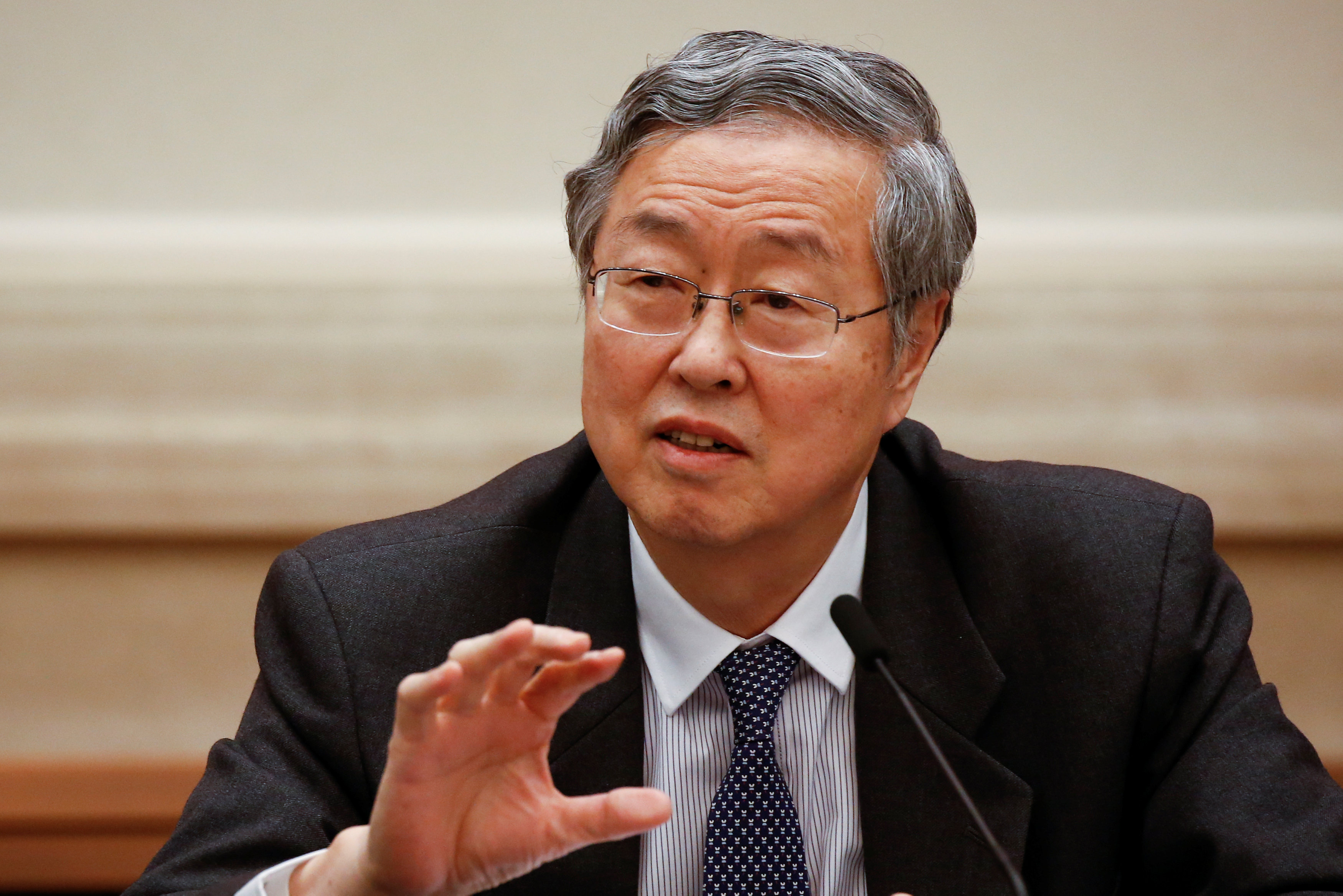 People's Bank of China Governor Zhou Xiaochuan says the credit risk of financial institutions has undermined confidence at home and abroad in China's financial system. Photo: Visual China