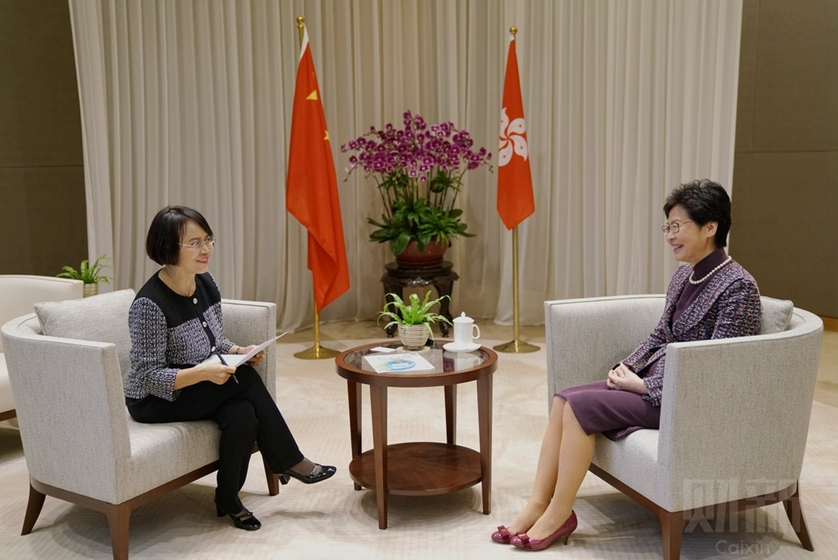 Hong Kong Chief Executive Carrie Lam (right) speaks with Hu Shuli, editor-in-chief of Caixin Media, about the special administrative region's ongoing challenges. Photo: Liang Yingfei/Caixin