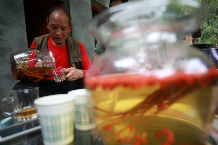 """Chinese distiller Guizhou Dongjiu advertised that one of its brands of baijiu liquor is """"antiseptic, antiviral, anti-cancer, anti-blood-clotting and can help reduce cholesterol"""" after a study suggested that its products have cancer-fighting properties. Photo: Visual China"""