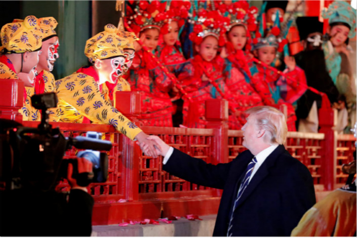 U.S. President Donald Trump, pictured here greeting opera performers after a Forbidden City performace, said that he and his