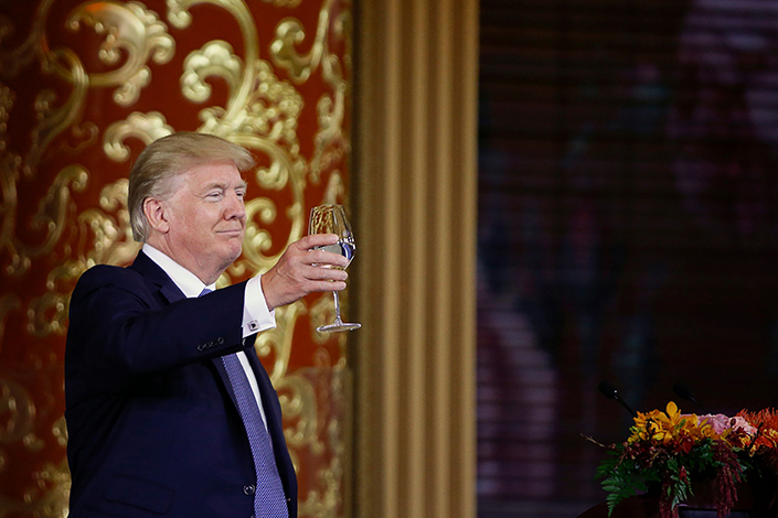 US President Donald Trump attends a state dinner hosted by China's President Xi Jinping in the Great Hall of the People in Beijing on November 9
