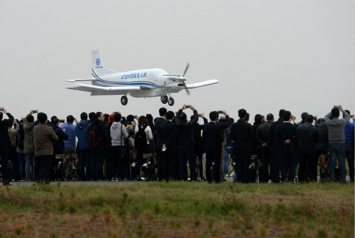A Chinese aviation official said that large drones won't begin commercial operations for some time because they currently fall outside existing aviation regulations. Above, China's heaviest cargo drone, the AT200, flies during its first public demonstration flight in Neifu Airport in Weinan, Shaanxi province, on Oct. 30. Photo: Visual China