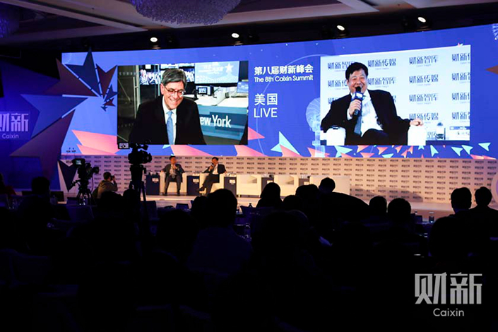 "Former U.S. Treasury Secretary Jack Lew said Wednesday that China's decision to allow foreign investors to take a 51% stake in financial companies was ""an important move,"" yet the government could do more to open up the sector. Above, Lew (left screen) and Chinese Finance Vice Minister Zhu Guangyao discuss Sino-U.S. economic cooperation via video links at the 8th Caixin Summit in Beijing on Wednesday. Photo: Caixin"
