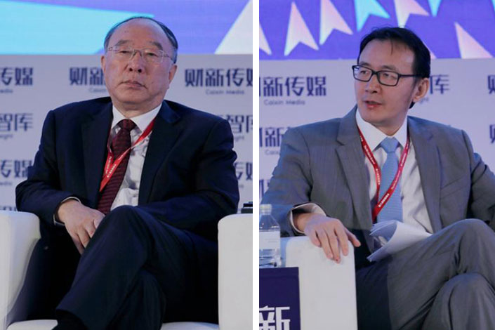 "Huang Qifan (left), vice chairman of the Financial and Economic Affairs Committee of the National People's Congress, said at the 8th Caixin Summit in Beijing on Thursday that ""It is high time for the foreign exchange reserve system to be reformed."" However, Xu Zhong (right), head of the central bank's research department, said that many of Huang's ideas are unrealistic. Photo: Du Guanglei/Caixin"