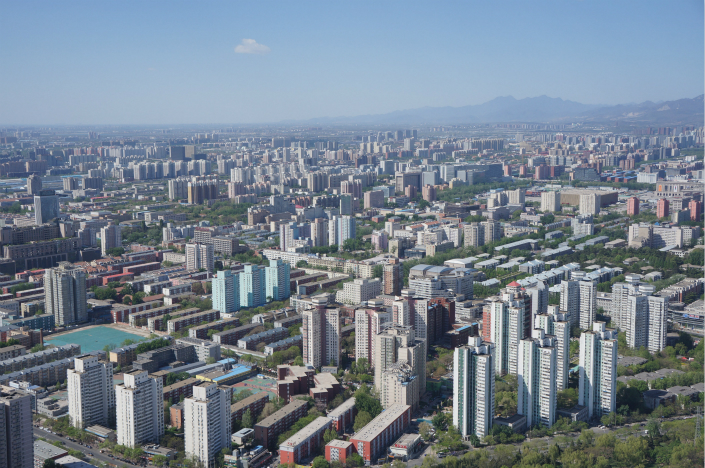 Beijing will allow rental housing to be built on 1,000 hectares (3.86 square miles) of rural land from 2017 to 2021. Above, residential buildings are seen in China's capital on April 18. Photo: Visual China