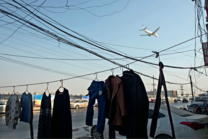 Clothes hang out to dry outside a home in the Zhengzhou Airport Economy Zone in Henan province in November 2016. Photo: Caixin