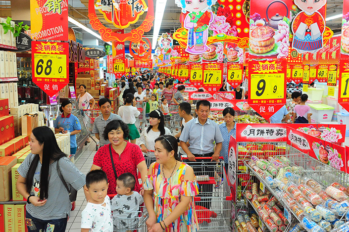 Alibaba will acquire its stake in Sun Art, which operates the RT-Mart and Auchan hypermarket chains in China, for HK$6.50 ($0.83) per share, well below the firm's last trading price of HK$8.60. Above, shoppers peruse an RT-Mart in Fuyang, Anhui province in August 2016. Photo: Visual China