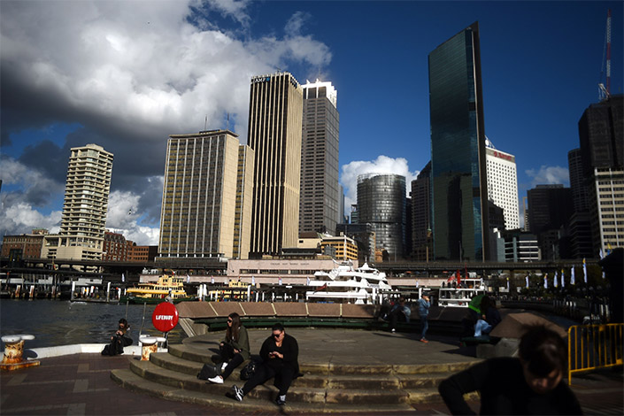 Wanda Group's transformation into an entertainment giant has landed it with huge debts, and has also put it at odds with a Beijing campaign to clamp down on overseas purchases by Chinese buyers in the leisure and entertainment sectors. The glass building on the right side of the above photo is Sydney's One Circular Quay, which Wanda owns. Photo: Visual China