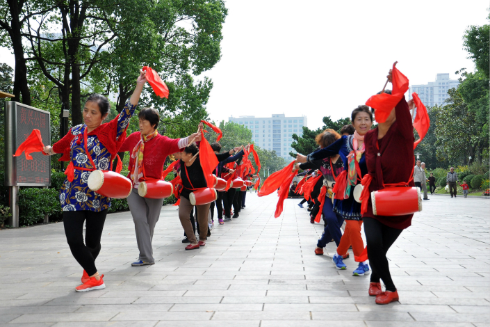 Analysts estimate that the state-owned enterprise shares transferred to government bodies in the recent pilot pension project could be worth as much as 4 trillion yuan ($603 billion). In the picture above, retirees dance in a Shanghai park in October. Photo: Visual China