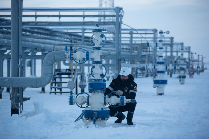 "PwC's Andrew Li noted that M&As with ""strategic significance,"" such as those in the energy sector, remained stable this year because deals were still ""encouraged by the government"" and ""welcomed by the market."" Above, an oil worker turns a control wheel in a field operated by Rosneft in East Siberia. China Huaxin Energy is buying a 14.16% stake in the company for $9.1 billion. Photo Visual China"