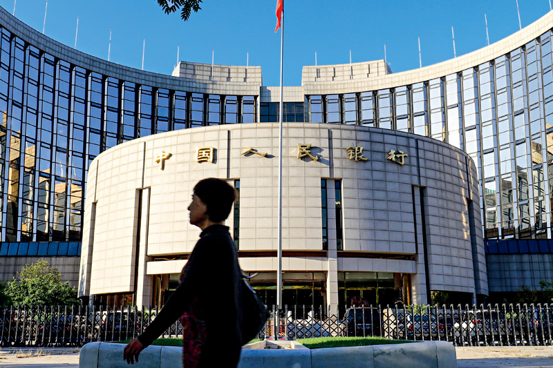 The People's Bank of China (above) and other regulatory bodies have unveiled a draft regulation that the central bank says aims to reduce arbitrage and ensure the healthy development of the entire asset management sector. Photo: Visual China