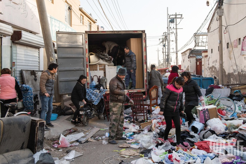 Tenants in a village in Daxing district in southern Beijing load their belonging into a truck on Friday after local authorities started to close overcrowded rental housing following a deadly fire a week ago. Photo: Xu Weichao/ Caixin