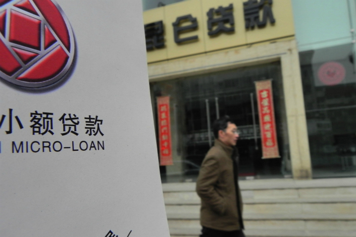 China's banking regulator and the central bank are drafting microlending rules to clarify what constitutes lawful lending and whether cross-regional online lending will be allowed. Photo: Visual China