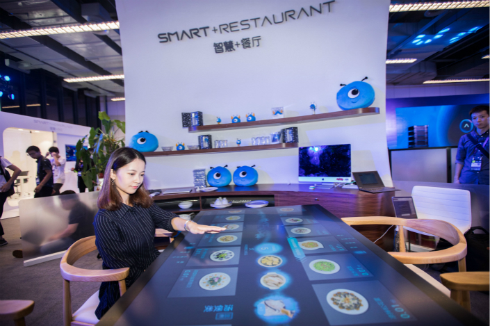 Several Chinese companies have recently showcased futuristic waiterless restaurants that can automatically take orders, serve food and handle bills. Photo: Visual China