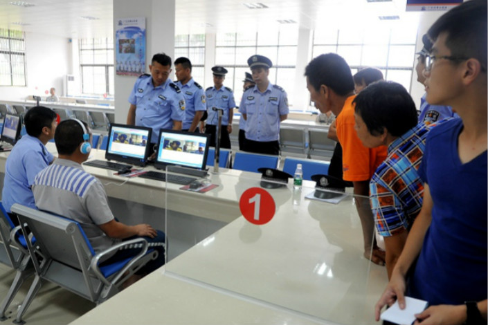 Family members watch an inmate talk to his relatives on a computer in June 2016 at Foshan Prison during in an open house day to showcase the prison's new system for inmates to communicate with family members over the internet. Photo: Foshan Prison