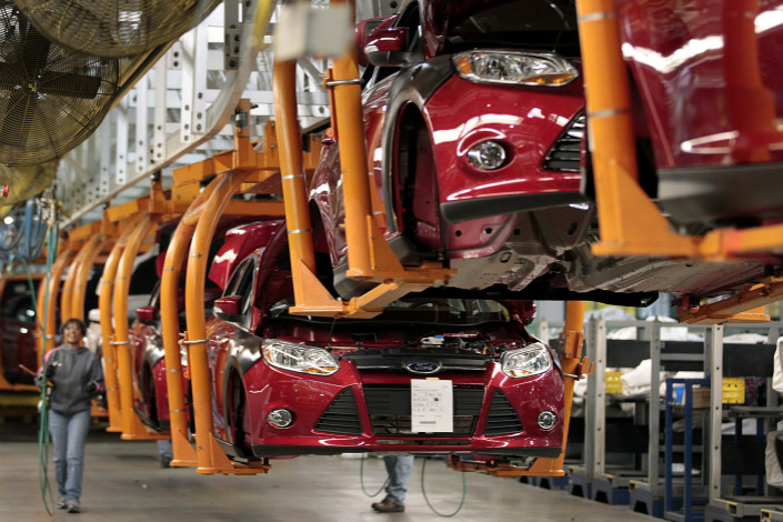 The new models that Ford plans to launch in China will include at least 15 electric models under the Ford and Lincoln brands. Above, vehicles get assembled at a Ford plant in the U.S. in December 2015. Photo: Visual China