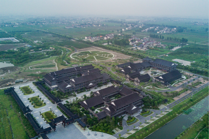 Characteristic towns, such as the one (pictured) in Jiangsu province that specializes in traditional Chinese medicine, were created to narrow the income gap between rural and urban areas and relieve overcrowding in larger cities. In many cases, however, they have become just another way for local governments to run up debt. Photo: Visual China