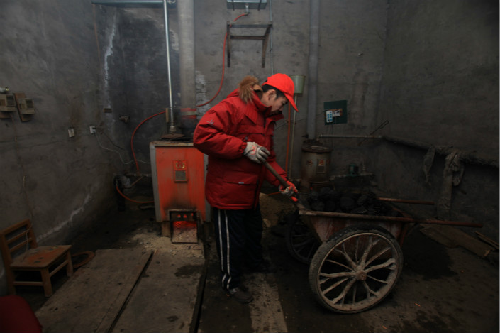 Some people left without heating by the government's recent actions have returned to burning coal, if they can access the fuel. One woman who has done so told Caixin that she had no other choice, faced with icy temperatures. Photo: Visual China