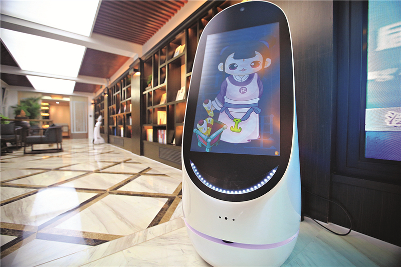 """Xiao Fake,"" a legal-services robot shown here on demonstration in a Beijing law bookstore, can help users by doing such things as identifying laws and guidelines, and searching for historical case records. Photo: Caixin"