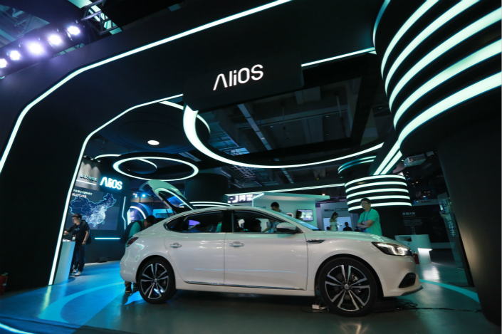 Alibaba Group Holding Ltd. has announced that it wants its AliOS software for automobiles to eventually be open source. Above, Alibaba demonstrates AliOS at its cloud conference in Hangzhou, Zhejiang province, on Oct. 11. Photo: IC
