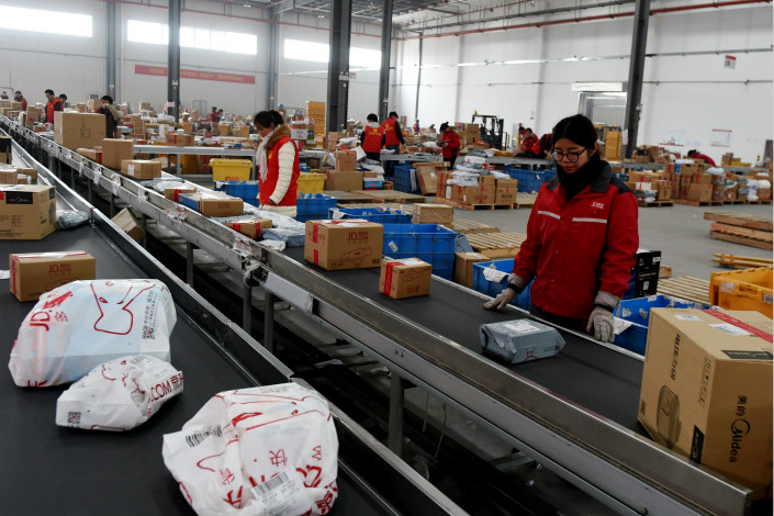 JD.com uses JD Logistics for the delivery of products sold in-house, which account for more than half of the merchandise it sells on its platform, while independent merchants on JD.com usually employ a private courier of their choice. Photo: Visual China