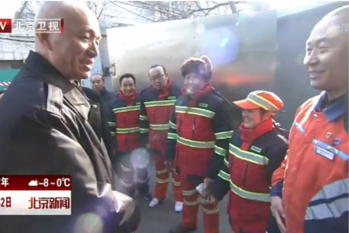 "Cai told a couple from Sichuan province who have been working as sanitation workers in Beijing for a decade that they deserve ""due respect and gratitude"" for their contribution to the community. Photo:Beijing TV"