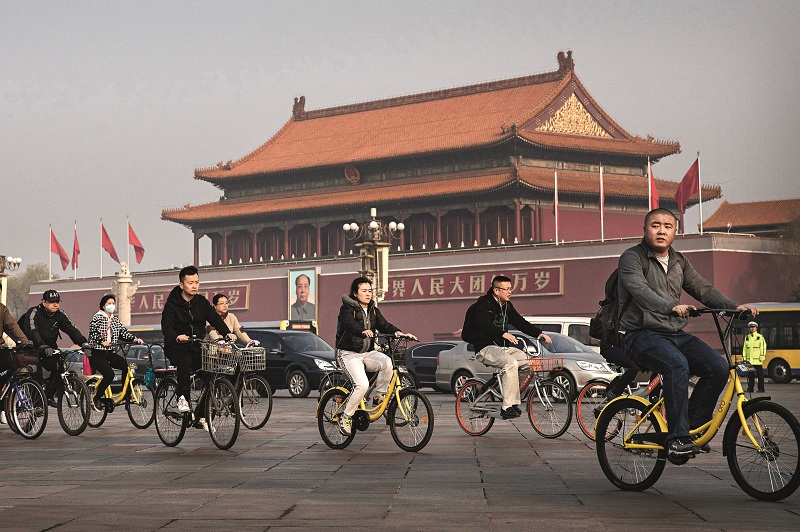 China's bike-sharing market grew to 3.9 billion yuan in the second quarter of 2017, with more than 100 million riders, according to iResearch. Above: riders pedal near Tiananmen Square in Beijing. Photo: Kevin Frayer/Getty Images