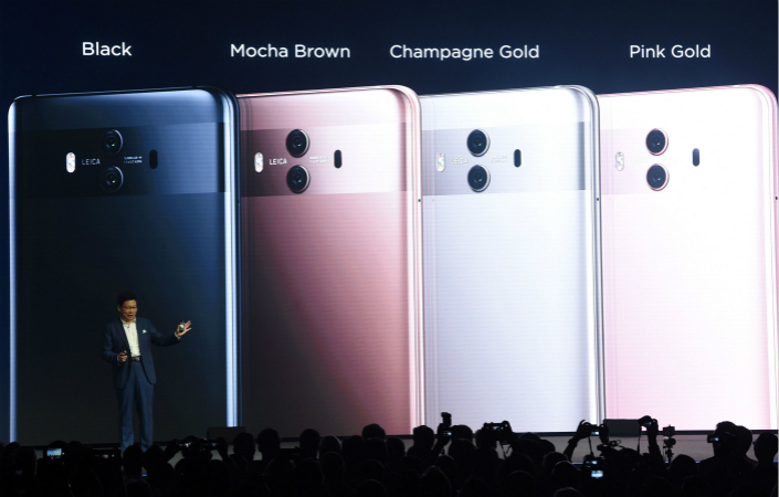 Huawei phones are currently available in the U.S. only through some electronics stores and online platforms, including its own U.S. website, Amazon and local retailer Best Buy. Above, the president of Huawei's consumer business, Richard Yu Chengdong, presents the Mate 10, which the company will soon allow U.S. carriers to sell. Photo: Visual China