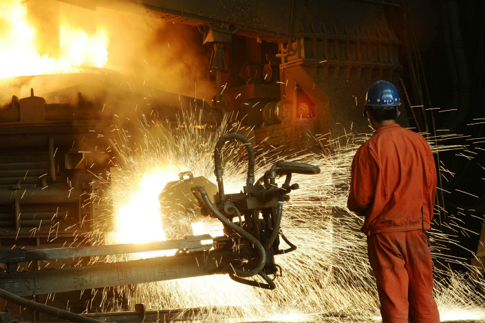 A worker watches steel production at a Dongbei Special Steel plant in the northeastern city of Dalian in October 2015. Photo: IC