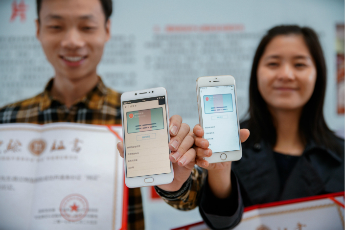 The southern city of Guangzhou issued China's first digital identification card on Monday. Initially, citizens will be able to use the virtual ID for government services, such as registering a company with the commerce authority in Guangzhou. Photo: Visual China
