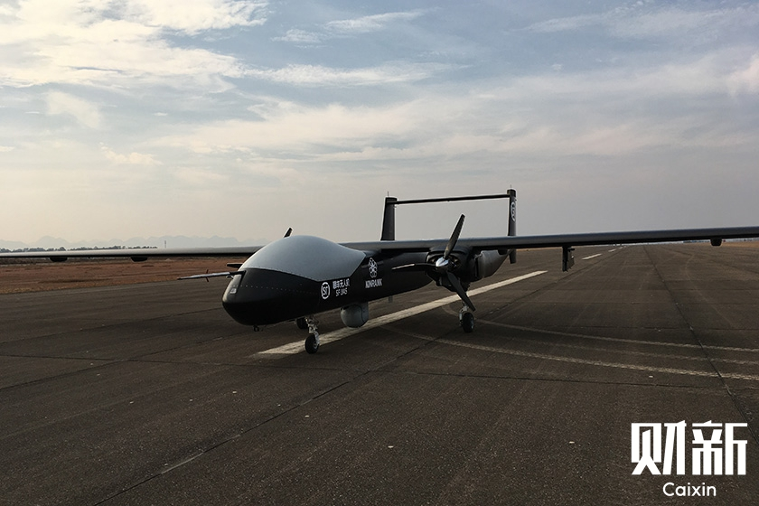 Express delivery giant SF Express completed a demonstration flight on Tuesday of the country's first large drone used for emergency logistics. Photo: Huang Rong/Caixin