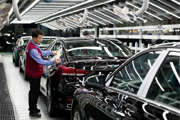Hyundai Motor Group sales slumped in China  last year amid diplomatic tensions between Beijing and Seoul over South Korea's deployment of a U.S. anti-ballistic-missile system. Above, a Hyundai Motor Co. Genesis luxury sedan gets a final inspection on a production line at the company's plant in Ulsan, South Korea, on April 24. Photo: Visual China