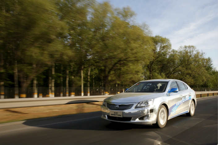 A testing zone for autonomous cars in the town of Yizhuang in suburban Beijing will be used exclusively for that purpose. Above, a modified Raeton sedan, a self-driving car from Changan Automobile (Group) Co. Ltd., is tested on a Beijing highway in April 2016. Photo: Visual China