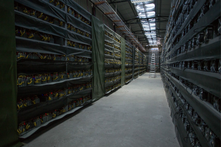The pictured Sichuan province bitcoin mine is one of many in western China, drawn to the region by of a supply of cheap wind power and hydroelectricity. Photo: Visual China